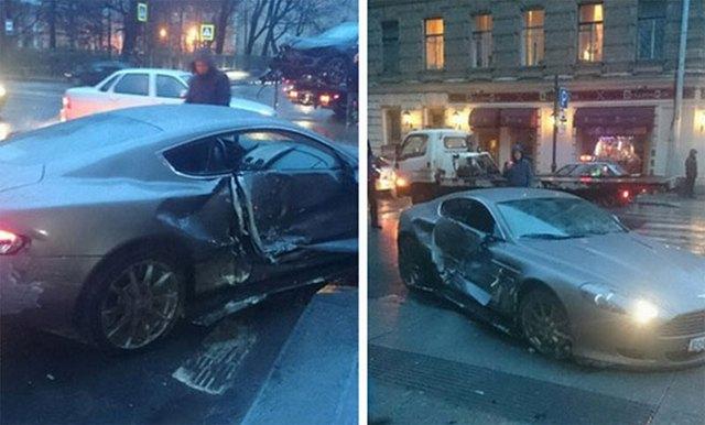 Chiếc Aston Martin bị hư hỏng khá nặng sau vụ tai nạn.