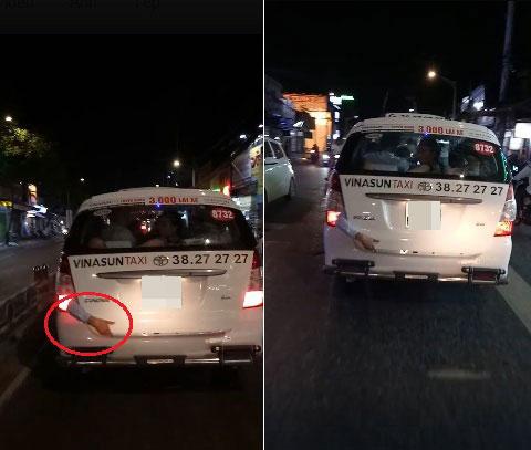 Cánh tay người đàn ông thò ra khỏi cốp chiếc taxi. Ảnh cắt từ video