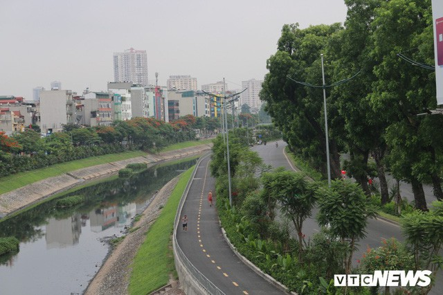 Ảnh: Đường Láng thay đổi bất ngờ, dân Thủ đô cứ ngỡ đang lạc vào đường phố Singapore - Ảnh 7.