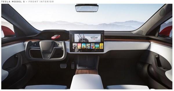 Elon Musk khoe xe điện chơi được game bom tấn - Ảnh 1.