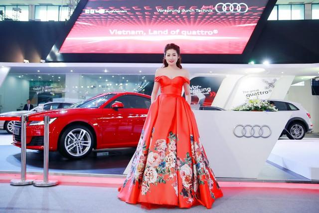 Á hậu Tú Anh rực rỡ váy đỏ trong ngày khai mạc VIMS 2015.