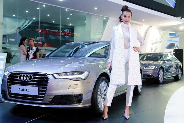 Siêu mẫu Thanh Hằng cùng chiếc xe Audi A6 mà cô làm đại sứ thương hi