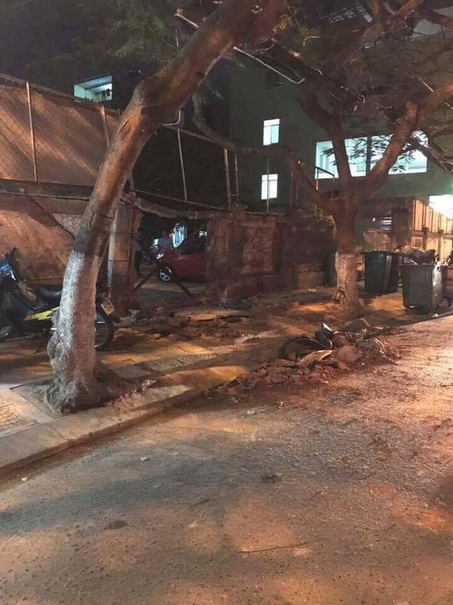 Đà Nẵng: Toyota Fortuner đâm Chevrolet Spark và húc thủng tường bãi giữ xe - Ảnh 3.