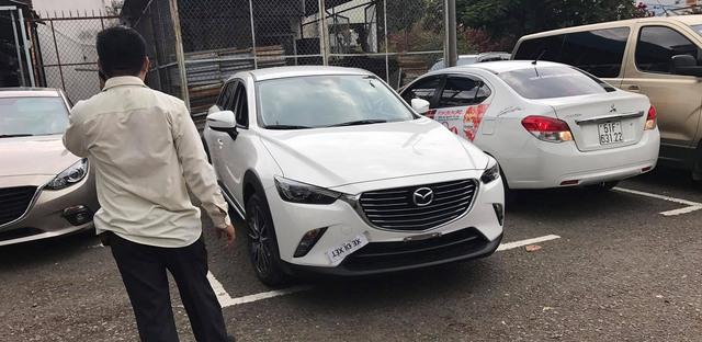 Mazda CX-3 bất ngờ được đưa đi đăng ký biển số tại Sài Gòn - Ảnh 1.