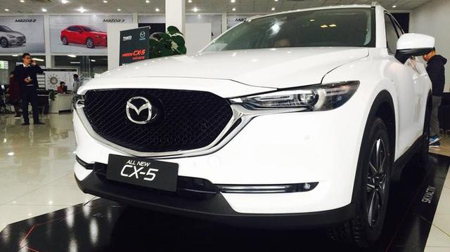 Mazda loạn giá xe giữa hãng và đại lý