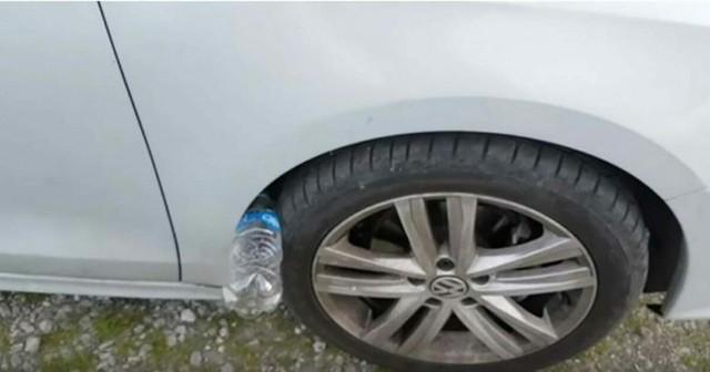 Nếu thấy lốp xe ô tô của bạn có nhét 1 chai nhựa, đừng chạm vào, hãy báo cảnh sát ngay - Ảnh 1.