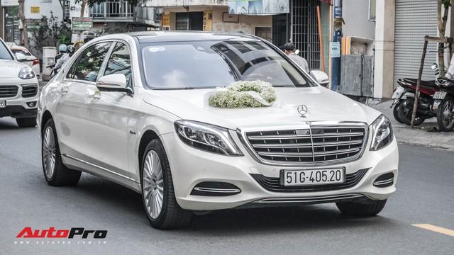 Thiếu gia Sài Gòn rước dâu bằng dàn xe sang trắng, đen hoành tráng - Ảnh 1.