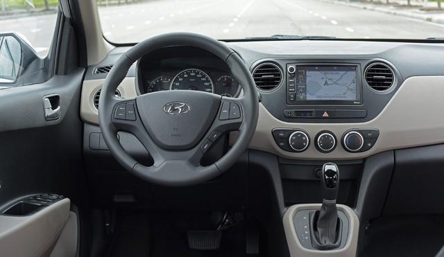 Hyundai Grand i10 thêm cân bằng điện tử, giá trên 390 triệu đồng - Ảnh 1.