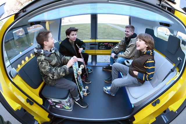 Học sinh sẽ được đi học trên xe bus tự lái ngầu như thế này đây - Ảnh 4.