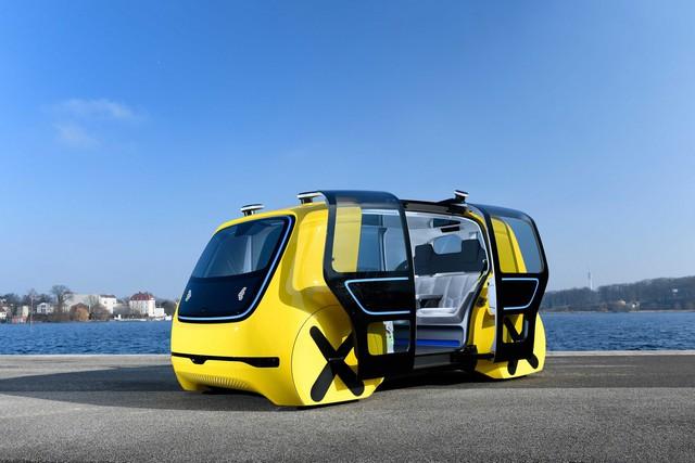 Học sinh sẽ được đi học trên xe bus tự lái ngầu như thế này đây - Ảnh 1.