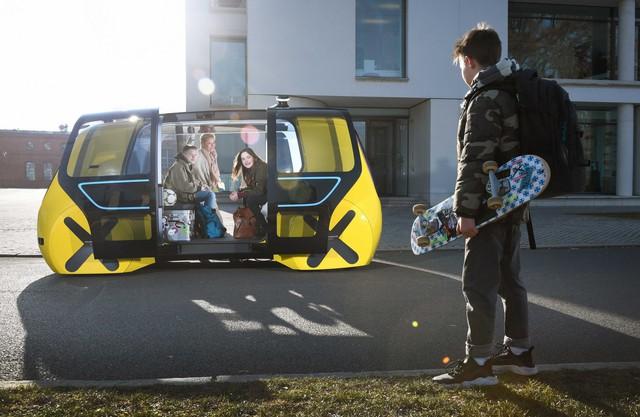 Học sinh sẽ được đi học trên xe bus tự lái ngầu như thế này đây - Ảnh 2.