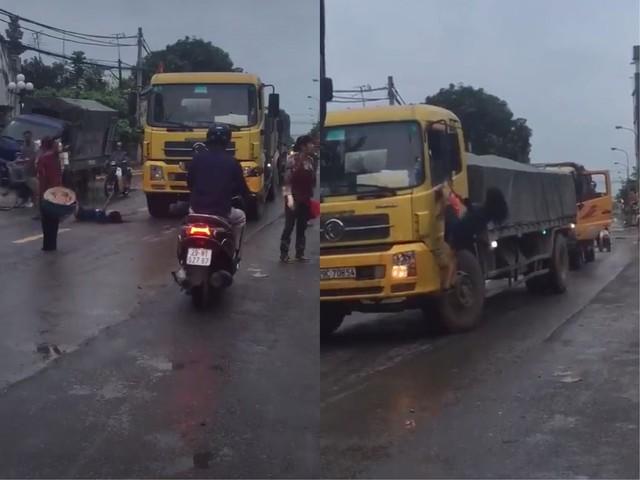 Hà Nội: Cô gái bất ngờ ra giữa đường chặn đầu xe tải rồi đánh đu lên gương xe khiến nhiều người hoảng hốt - Ảnh 1.