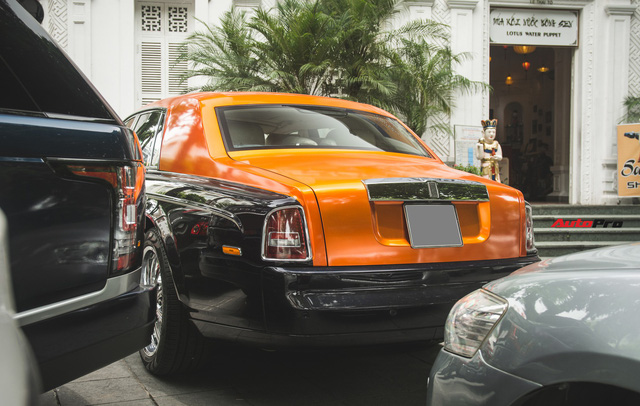Chiếc Rolls-Royce Phantom tại Hà Nội đổi màu nhanh như tắc kè: Vừa hết tím mộng mơ lại đến cam cá tính - Ảnh 7.