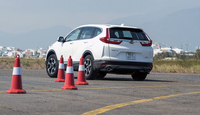 Honda CR-V 7 chỗ chỉ có 2 phiên bản, giá niêm yết cao nhất hơn 1,25 tỷ đồng - Ảnh 2.