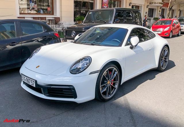 Doanh nhân Nguyễn Quốc Cường cầm lái Porsche 911 Carrera S tiền tỷ xuống phố - Ảnh 1.