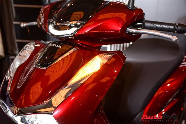 Những điểm mới trên Honda SH 125i/150i vừa ra mắt Việt Nam: Hổ mọc thêm cánh - Ảnh 4.