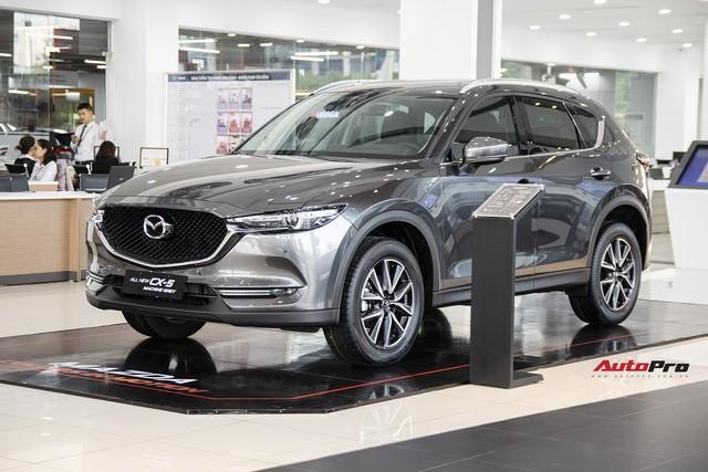 Mazda CX-5 và Honda CR-V đua giảm giá sốc tại đại lý, nhiều nhất 70 triệu đồng - Ảnh 1.