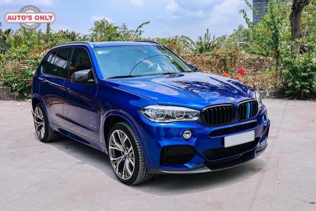 Dân chơi Bạc Liêu chi 1 tỷ đồng biến hóa BMW X5, ghép cặp với Ford Ranger Raptor - Ảnh 1.