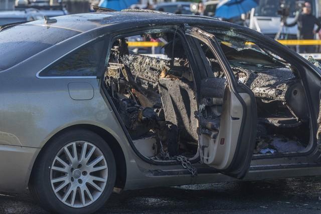 Bố nhốt con trong xe Audi, khóa cửa đốt xe rồi bỏ chạy - Ảnh 1.