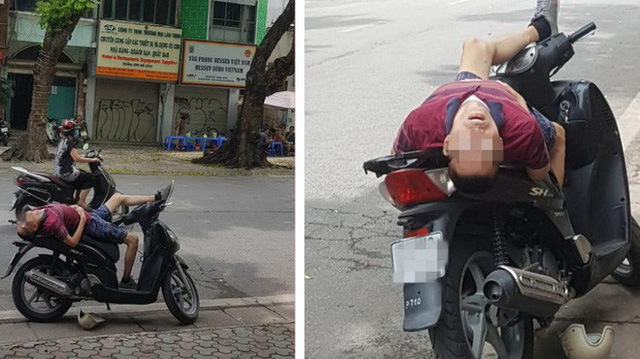 Người đàn ông nằm trên xe SH với tư thế kỳ lạ giữa đường khiến nhiều người chú ý