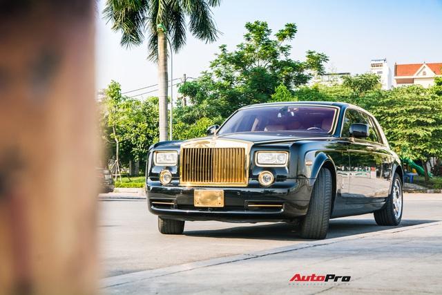 Rolls-Royce Phantom độ phiên bản rồng, mạ vàng có giá bao nhiêu trên sàn xe lướt? - Ảnh 1.