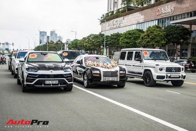 Dàn xe 100 tỷ nhà Minh Nhựa đi diễu hành tại Sài Gòn trong ngày đám cưới cô con gái sinh năm 1999 - Ảnh 1.