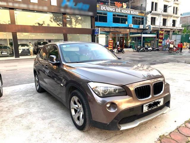 7 năm chạy 75.000km, BMW X1 bán lại rẻ hơn Kia Seltos gần 100 triệu đồng - Ảnh 1.