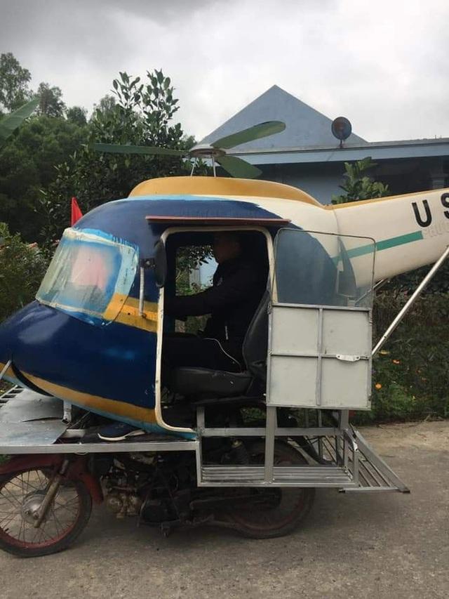 Chiếc máy bay di chuyển trên đường làng, nhìn kỹ ai cũng bật cười - Ảnh 1.