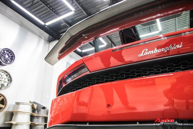 Cận cảnh Lamborghini Huracan màu đỏ thứ ba tại Việt Nam - Chiếc Huracan duy nhất trong nước sơn màu thay vì dán decal - Ảnh 9.