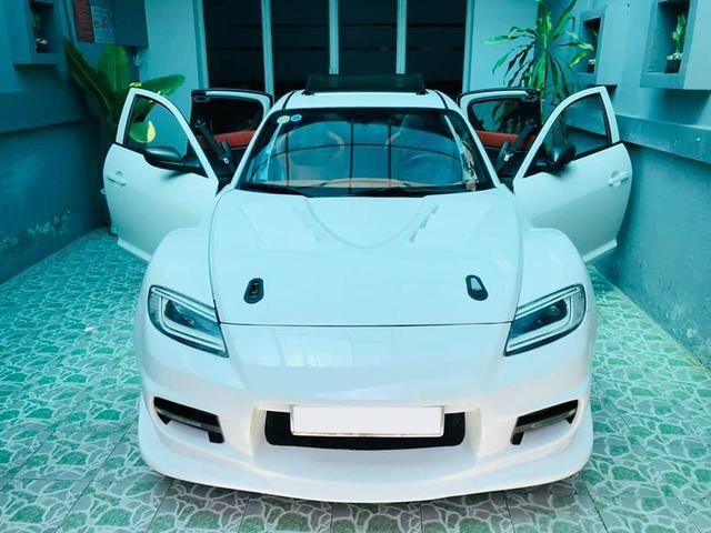 Hàng hiếm Mazda RX-8 gắn logo Ferrari bán lại với giá ngang ngửa Toyota Vios số sàn - Ảnh 1.