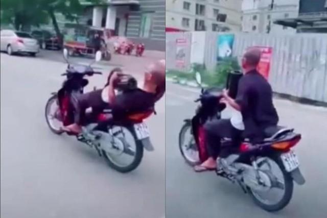 Quái xế 62 tuổi buông 2 tay phóng xe vèo vèo ở Hà Nội bị phạt 8,25 triệu đồng - Ảnh 1.