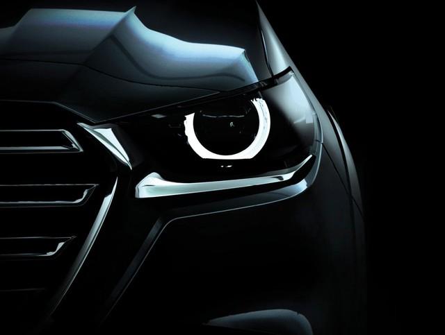 Mazda BT-50 thế hệ mới lại nhá hàng, chuẩn bị cho lễ ra mắt ngày mai - Ảnh 1.