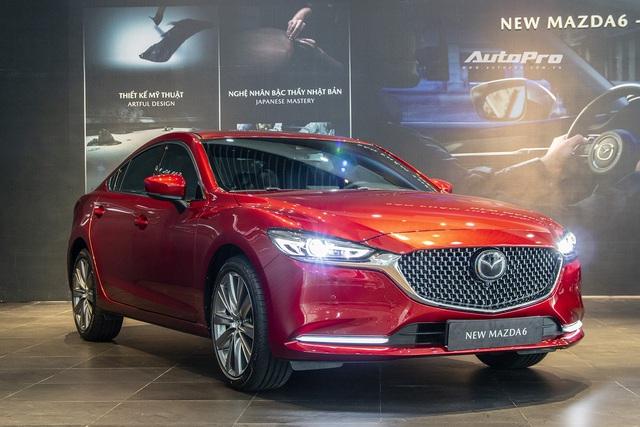 Loạt xe vừa mở bán đã giảm giá hàng chục triệu đồng: Mazda6 nhận ưu đãi kép, Suzuki Ertiga hạ giá sốc - Ảnh 2.