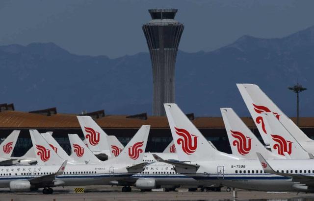 La liệt máy bay nằm không tại sân bay trên khắp thế giới - Ảnh 7.