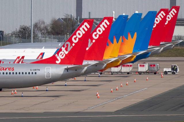 La liệt máy bay nằm không tại sân bay trên khắp thế giới - Ảnh 9.