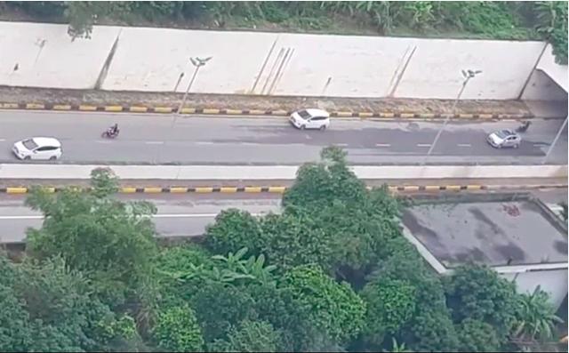 Ô tô 7 chỗ đi lùi trên Đại lộ Thăng Long: Đoạn clip bóc trần sự khôn lỏi của tài xế - Ảnh 1.