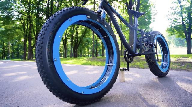 Kỹ sư thiết kế xe đạp không trục, không nan hoa mà vẫn chạy tốt - Ảnh 1.