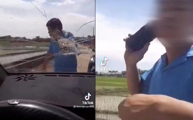 Người đàn ông chặn đầu ô tô, lấy đá ném vỡ kính xe, cái kết cuối khiến tất cả hả hê - Ảnh 1.