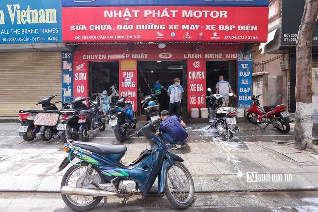 Dịch vụ sửa xe ở Hà Nội quá tải sau khi mở cửa trở lại - Ảnh 11.