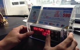 Giá cước taxi đồng loạt giảm theo giá xăng