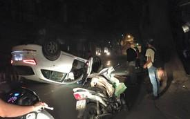 Hà Nội: Audi Q5 đâm gốc cây, lật ngửa giữa đêm