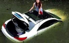 Nữ tài xế lái xe sang Mercedes-Benz CLS lao xuống kênh nước