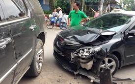 Va chạm Cadillac Escalade, Toyota Altis vỡ tan cản trước