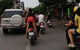 """Hà Nội: Clip cô gái trẻ """"làm xiếc"""" trên phố, vừa đứng sau vừa lái xe vừa hôn hít bạn trai"""