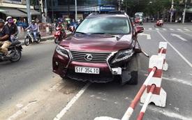 Phong tỏa cầu Calmette vì Lexus bạc tỉ tông dải phân cách