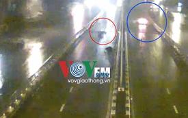 Đi ngược chiều trên cầu vượt Ngã Tư Sở, bị ô tô hất qua dải phân cách