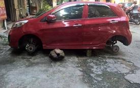 """Tháng cô hồn: Kia Morning bị trộm """"vặt"""" sạch 4 bánh xe"""