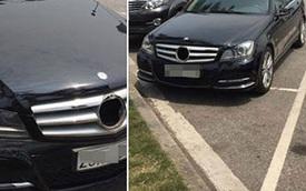 """Đỗ trong bãi gửi xe của sân bay Nội Bài, ô tô Mercedes bị """"vặt gương"""" và logo"""
