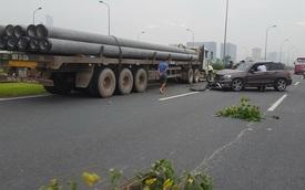 Va chạm với Mercedes-Benz GLK trên đại lộ Thăng Long, xe container gãy trục