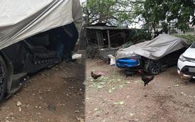 Sau tai nạn, BMW i8 xanh ngọc định cư gần chuồng gà